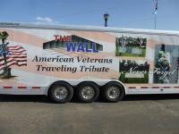 The transport carrying the replica of the Vietnam Wall.