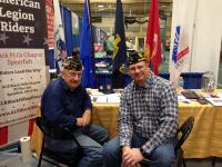 Post 164 Adjutant Ron Schuttler and Post 164 Chaplain Brian Dean manning the application table.